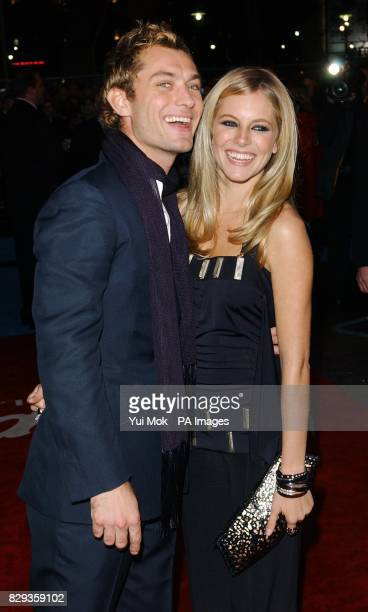 Stars of the film Jude Law and Sienna Miller arrive for the world charity premiere of Alfie at the Empire Leicester Square in central London in aid...