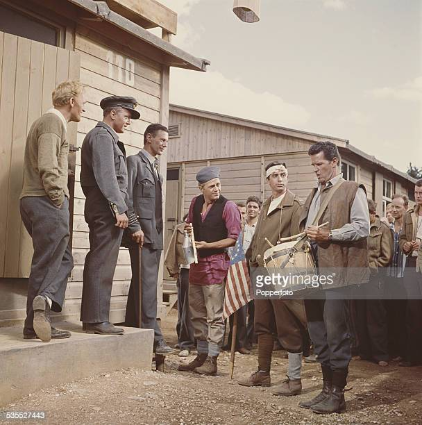 Stars of the film 'The Great Escape' pictured together shooting a scene inside a mock prisoner of war camp set in Germany in 1962 From left to right...