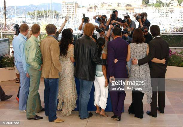 Stars of the film The Matrix Reloaded have their photo taken at a photocall