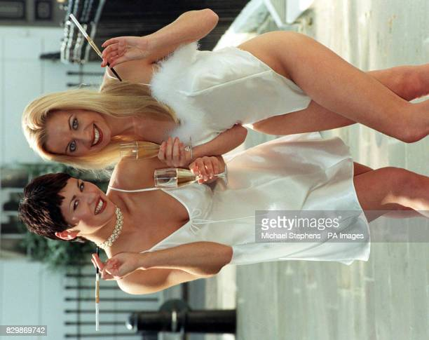 Stars of TV's 'Man O Man' Fleur modelling a Satin short robe with marabou trim over ivory chemise with marabou pompoms and Clare wearing an ivory...