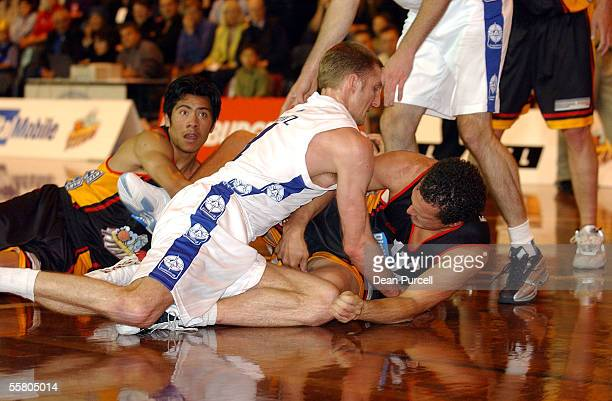 Stars player Simon Mesritz and Earl Smith fight for the ball during the NBL Basketball game the Waikato Titans vs the Auckland Stars played at the...