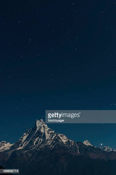 Stars shining over Machapuchare Fishtail mountain Himalayas Nepal