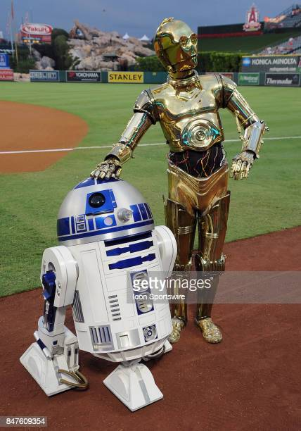 Stars Wars R2D2 and C3PO on the field during Star Wars night at Angel Stadium before a game between the Los Angeles Angels of Anaheim and the Texas...