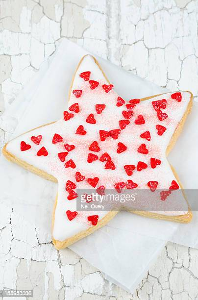 Star-shaped cookie with love hearts