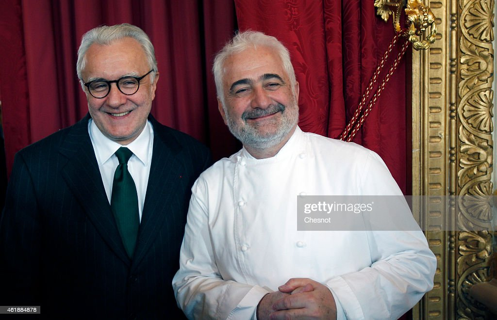 Starstudded French Chefs Alain Ducasse and Guy Savoy pose prior a press conference for the presentation of the 'Gout de France [taste of France] /...