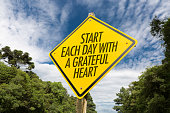 Start Each Day With a Grateful Heart road sign