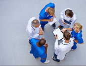High angle shot of a group of doctors talking with each other