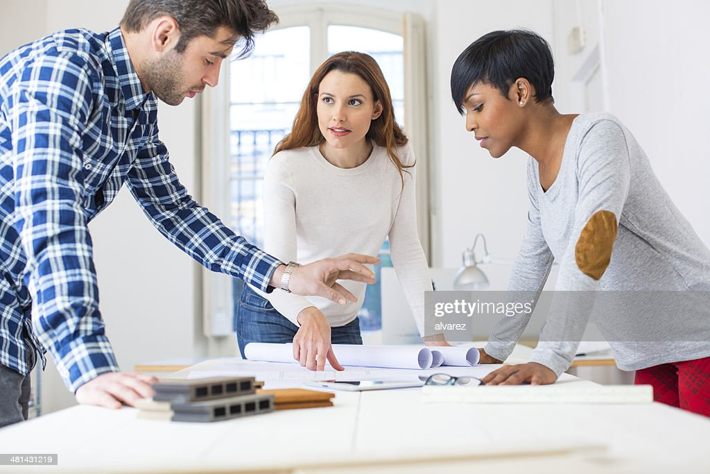 Start up colleagues, architects or students : Stock Photo