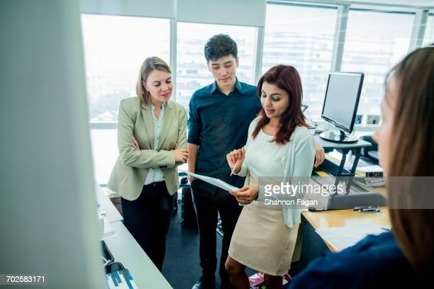 Start up colleagues discussing plans in office
