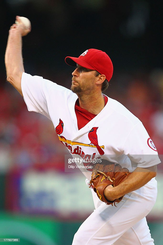 Starter <a gi-track='captionPersonalityLinkClicked' href=/galleries/search?phrase=Adam+Wainwright&family=editorial&specificpeople=547879 ng-click='$event.stopPropagation()'>Adam Wainwright</a> #50 of the St. Louis Cardinals pitches against the Atlanta Braves at Busch Stadium on August 23, 2013 in St. Louis, Missouri.
