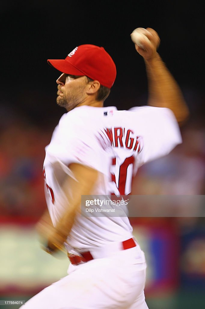 Starter <a gi-track='captionPersonalityLinkClicked' href=/galleries/search?phrase=Adam+Wainwright&family=editorial&specificpeople=547879 ng-click='$event.stopPropagation()'>Adam Wainwright</a> #50 of the St. Louis Cardinals pitches against the Atlanta Braves at Busch Stadium on August 23, 2013 in St. Louis, Missouri. The Cardinals beat the Braves 3-1.