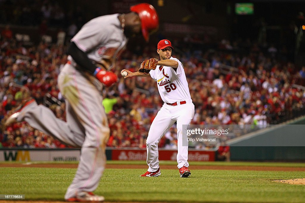 Starter <a gi-track='captionPersonalityLinkClicked' href=/galleries/search?phrase=Adam+Wainwright&family=editorial&specificpeople=547879 ng-click='$event.stopPropagation()'>Adam Wainwright</a> #50 of the St. Louis Cardinals throws out Brandon Phillips #4 of the Cincinnati Reds at first base in the sixth inning at Busch Stadium on April 29, 2013 in St. Louis, Missouri. The Reds beat the Cardinals 2-1.