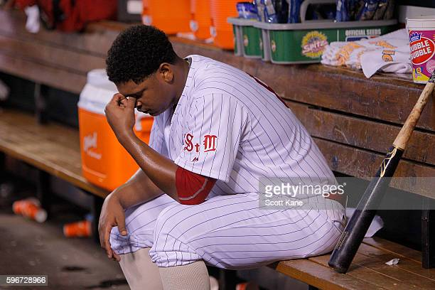 Starter Alex Reyes of the St Louis Cardinals sits on a bench in the dugout after being relieved from the mound during the fifth inning of a baseball...