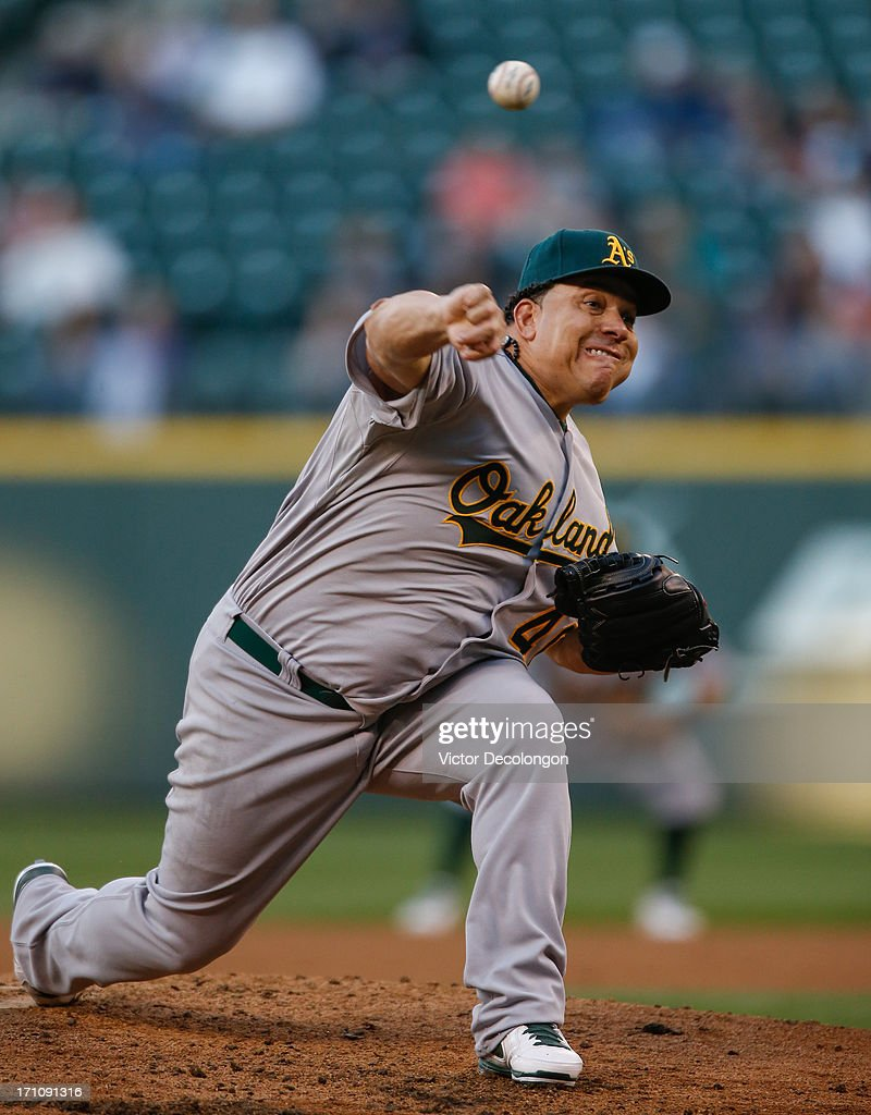 Starter <a gi-track='captionPersonalityLinkClicked' href=/galleries/search?phrase=Bartolo+Colon&family=editorial&specificpeople=175812 ng-click='$event.stopPropagation()'>Bartolo Colon</a> #40 of the Oakland Athletics pitches against the Seattle Mariners at Safeco Field on June 21, 2013 in Seattle, Washington. The Athletics defeated the Mariners 6-3.