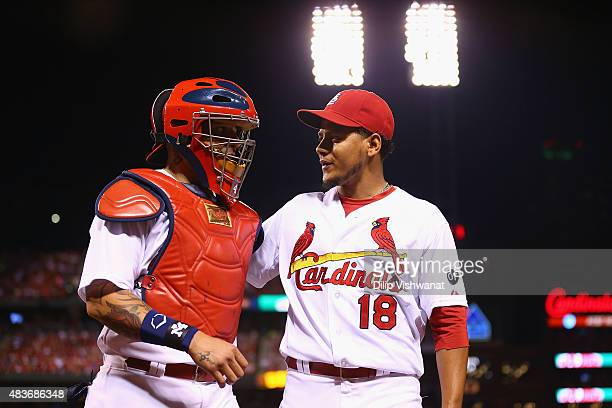 Starter Carlos Martinez and Yadier Molina of the St Louis Cardinals leave the field after picking against the Pittsburgh Pirates in the sixth inning...