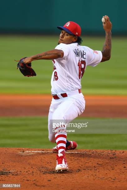 Starter Carlos Martinez of the St Louis Cardinals delivers a pitch against the Washington Nationals in the second inning at Busch Stadium on July 2...