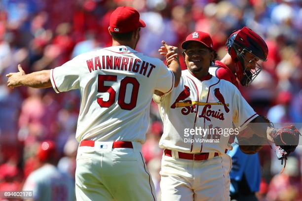 Starter Carlos Martinez of the St Louis Cardinals is congratulated by teammate Adam Wainwright after pitching a complete game against the...