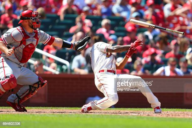 Starter Carlos Martinez of the St Louis Cardinals is hit by a pitch as Cameron Rupp of the the Philadelphia Phillies catches in the seventh inning at...