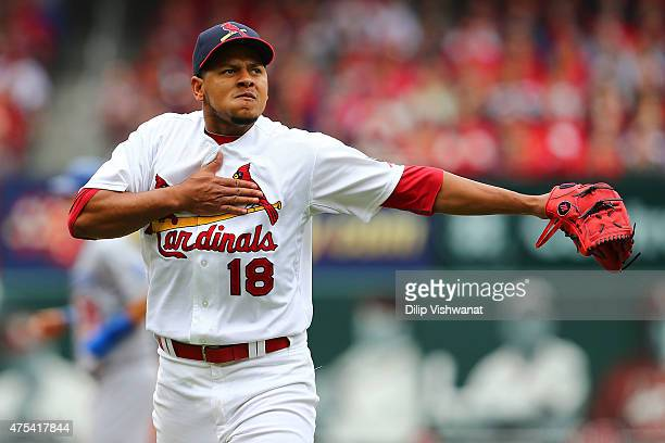 Starter Carlos Martinez of the St Louis Cardinals pounds his chest after recording his third strike out of the sixth inning against the Los Angeles...