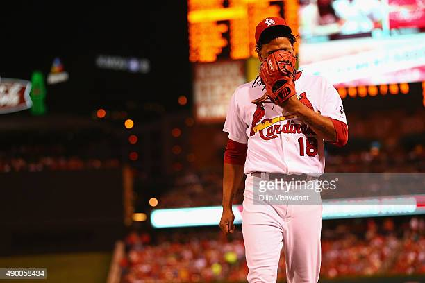 Starter Carlos Martinez of the St Louis Cardinals reacts after being pulled from the game against the Milwaukee Brewers due to shoulder tightness in...