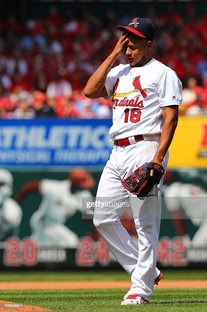Starter Carlos Martinez #18 of the St. Louis Cardinals reacts after giving up a two-run home run against the St. Louis Cardinals in the seventh inning at Busch Stadium on May 1, 2016 in St. Louis, Missouri.