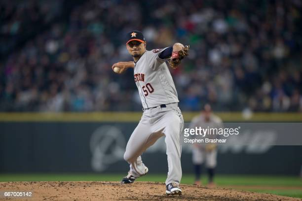 Starter Charlie Morton of the Houston Astros delivers a pitch during the third inning of the against the Seattle Mariners home opener at Safeco Field...