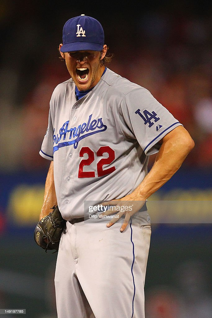 Starter Clayton Kershaw of the Los Angeles Dodgers reacts to walking in a run against the St Louis Cardinals at Busch Stadium on July 24 2012 in St...
