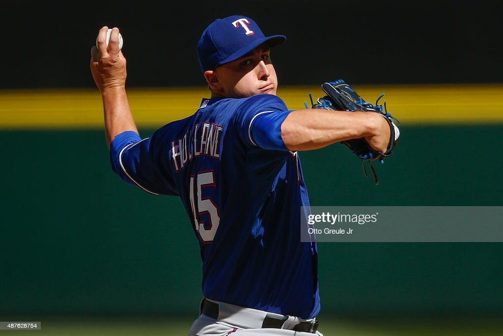 Starter <a gi-track='captionPersonalityLinkClicked' href=/galleries/search?phrase=Derek+Holland+-+Baseball+Player&family=editorial&specificpeople=8003703 ng-click='$event.stopPropagation()'>Derek Holland</a> #45 of the Texas Rangers pitches against the Seattle Mariners in the fifth inning at Safeco Field on September 10, 2015 in Seattle, Washington. The Mariners defeated the Rangers 5-0.