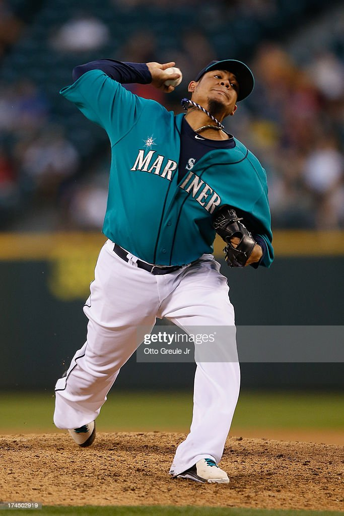 Starter <a gi-track='captionPersonalityLinkClicked' href=/galleries/search?phrase=Felix+Hernandez&family=editorial&specificpeople=550749 ng-click='$event.stopPropagation()'>Felix Hernandez</a> #34 of the Seattle Mariners pitches against the Minnesota Twins at Safeco Field on July 26, 2013 in Seattle, Washington.
