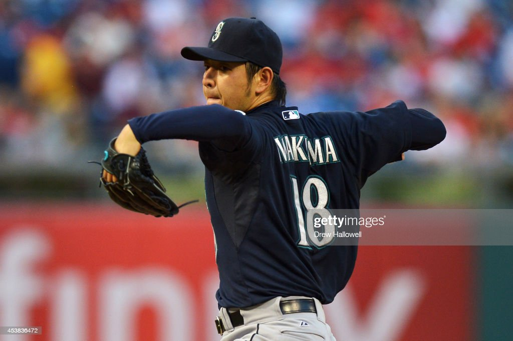 Starter Hisashi Iwakuma #18 of the Seattle Mariners delivers a pitch in the first inning against the Philadelphia Philliesat Citizens Bank Park on August 19, 2014 in Philadelphia, Pennsylvania.