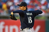 Starter Hisashi Iwakuma of the Seattle Mariners delivers a pitch in the first inning against the Philadelphia Philliesat Citizens Bank Park on August...