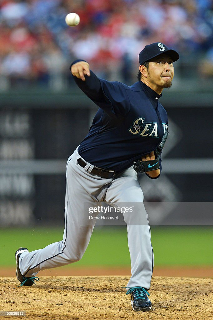 Starter Hisashi Iwakuma of the Seattle Mariners delivers a pitch against the Philadelphia Phillies in the second inning at Citizens Bank Park on...