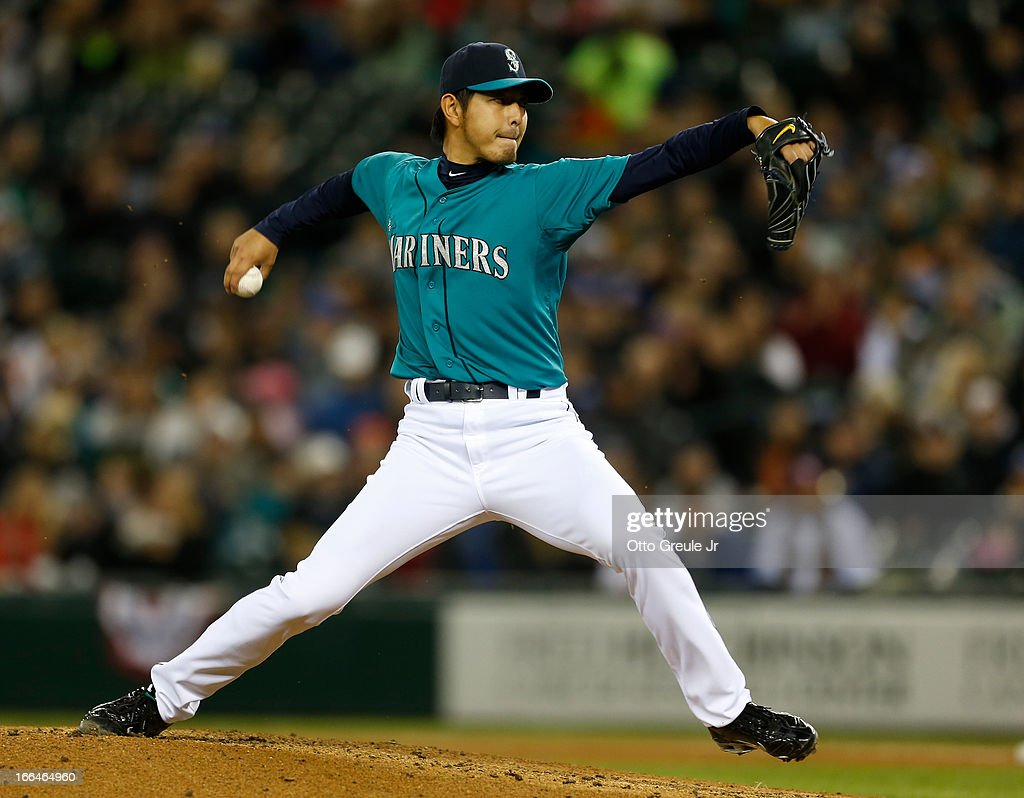 Starter <a gi-track='captionPersonalityLinkClicked' href=/galleries/search?phrase=Hisashi+Iwakuma&family=editorial&specificpeople=5723798 ng-click='$event.stopPropagation()'>Hisashi Iwakuma</a> #18 of the Seattle Mariners pitches against the Texas Rangers at Safeco Field on April 12, 2013 in Seattle, Washington.
