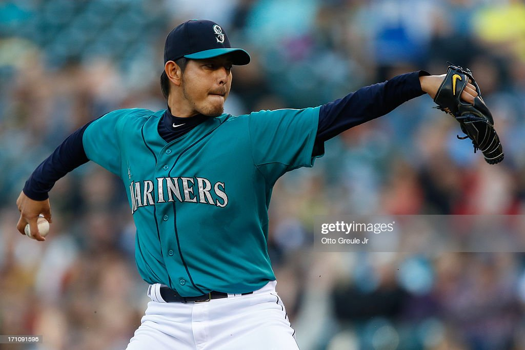 Starter <a gi-track='captionPersonalityLinkClicked' href=/galleries/search?phrase=Hisashi+Iwakuma&family=editorial&specificpeople=5723798 ng-click='$event.stopPropagation()'>Hisashi Iwakuma</a> #18 of the Seattle Mariners pitches against the Oakland Athletics at Safeco Field on June 21, 2013 in Seattle, Washington. The Athletics defeated the Mariners 6-3.