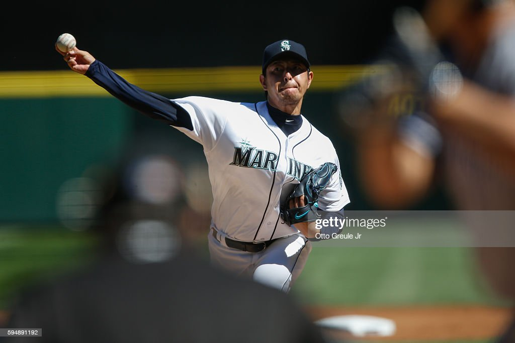 Starter Hisashi Iwakuma of the Seattle Mariners pitches against the New York Yankees in the first inning at Safeco Field on August 24 2016 in Seattle...