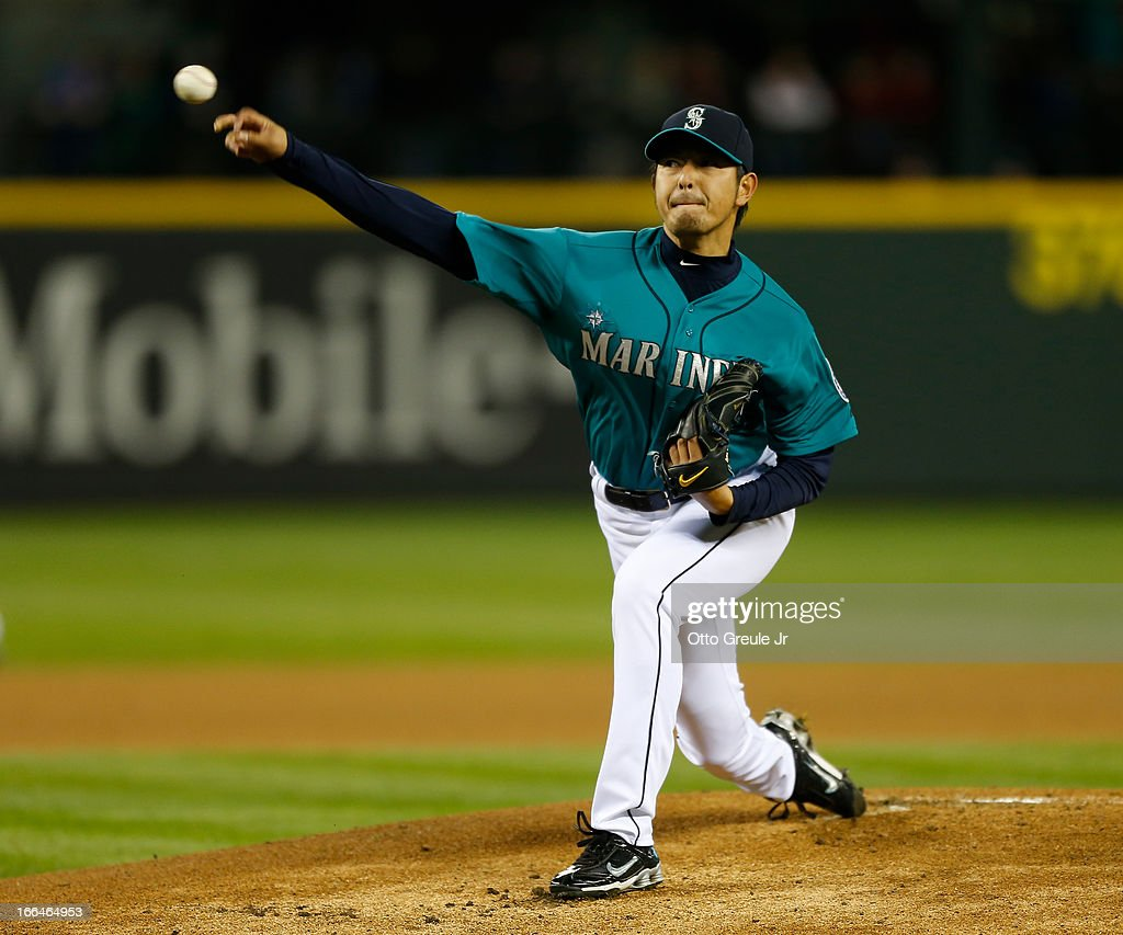 Starter <a gi-track='captionPersonalityLinkClicked' href=/galleries/search?phrase=Hisashi+Iwakuma&family=editorial&specificpeople=5723798 ng-click='$event.stopPropagation()'>Hisashi Iwakuma</a> #18 of the Seattle Mariners pitches in the first inning against the Texas Rangers at Safeco Field on April 12, 2013 in Seattle, Washington.