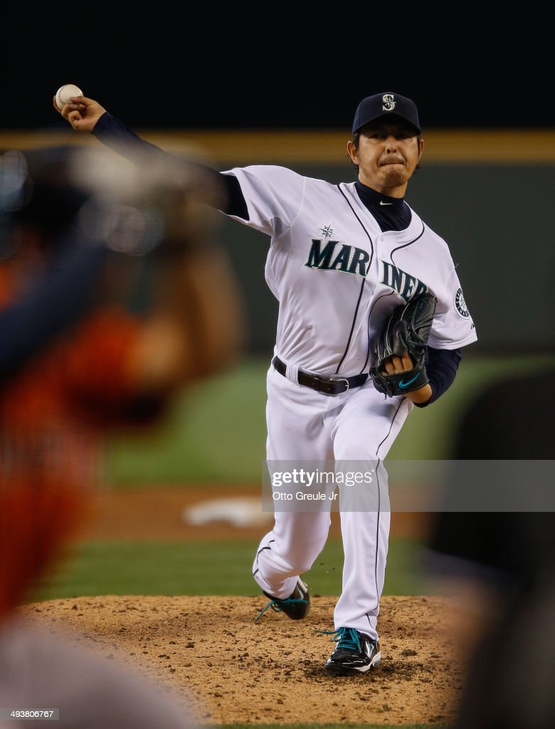 Starter Hisashi Iwakuma of the Seattle Mariners pitches in the third inning against the Houston Astros at Safeco Field on May 25 2014 in Seattle...