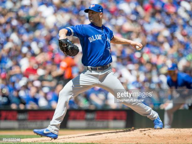 Starter JA Happ of the Toronto Blue Jays delivers a pitch during the first inning of a game against the Seattle Mariners at Safeco Field on June 11...