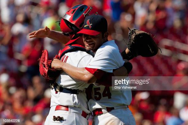 Starter Jaime Garcia of the St Louis Cardinals celebrates his threehit game with teammate Yadier Molina against the San Francisco Giants at Busch...
