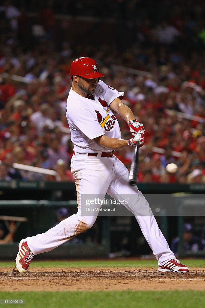 Starter <a gi-track='captionPersonalityLinkClicked' href=/galleries/search?phrase=Jake+Westbrook&family=editorial&specificpeople=207132 ng-click='$event.stopPropagation()'>Jake Westbrook</a> #35 of the St. Louis Cardinals collects his third hit of the game with an RBI single against the San Diego Padres in the sixth inning at Busch Stadium on July 19, 2013 in St. Louis, Missouri.