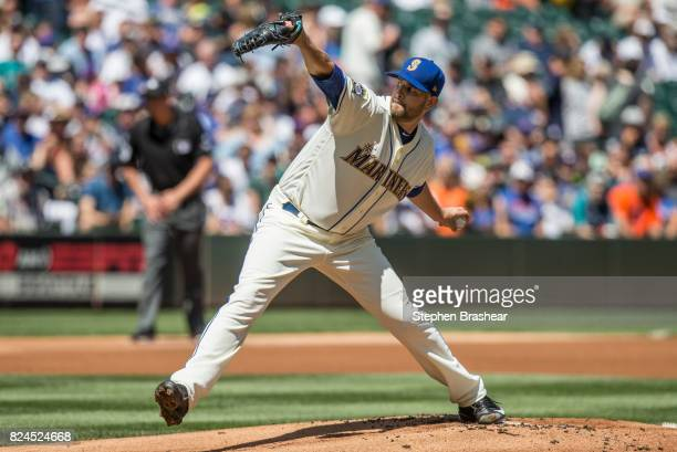 Starter James Paxton of the Seattle Mariners delivers a pitch during the first inning of an interleague game against the New York Mets at Safeco...