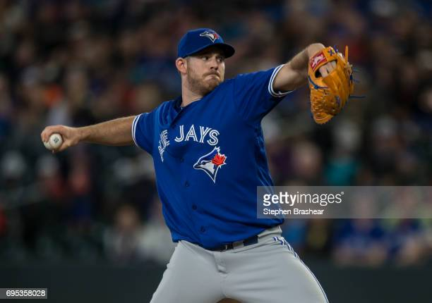 Starter Joe Biagini of the Toronto Blue Jays delivers a pitch during a game against the Seattle Mariners at Safeco Field on June 9 2017 in Seattle...
