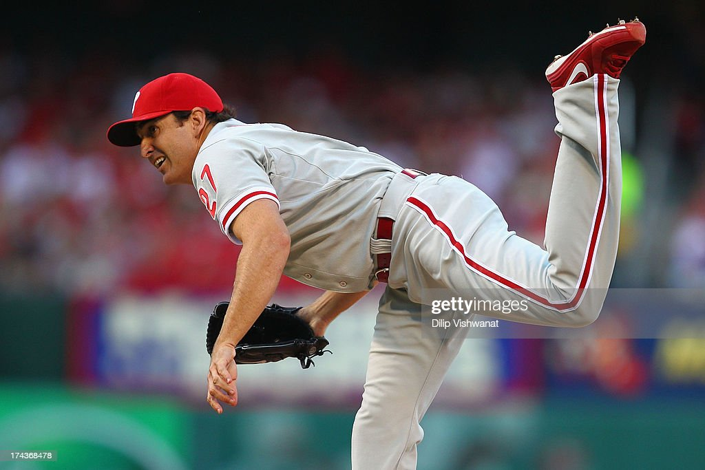 Starter <a gi-track='captionPersonalityLinkClicked' href=/galleries/search?phrase=John+Lannan&family=editorial&specificpeople=4432497 ng-click='$event.stopPropagation()'>John Lannan</a> #27 of the Philadelphia Phillies pitches against the St. Louis Cardinals at Busch Stadium on July 24, 2013 in St. Louis, Missouri.