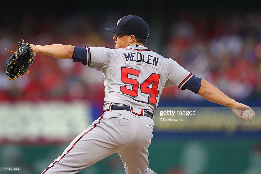 Starter <a gi-track='captionPersonalityLinkClicked' href=/galleries/search?phrase=Kris+Medlen&family=editorial&specificpeople=5743982 ng-click='$event.stopPropagation()'>Kris Medlen</a> #54 of the Atlanta Braves pitches against the St. Louis Cardinals at Busch Stadium on August 23, 2013 in St. Louis, Missouri.
