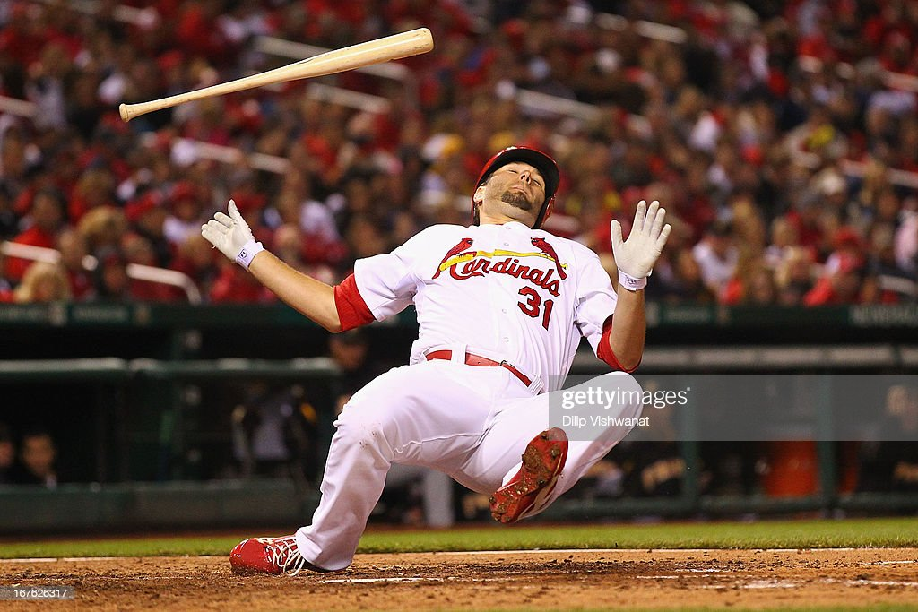 Starter Lance Lynn of the St Louis Cardinals dodges an inside pitch while attempting to bunt against the Pittsburgh Pirates during the sixth inning...
