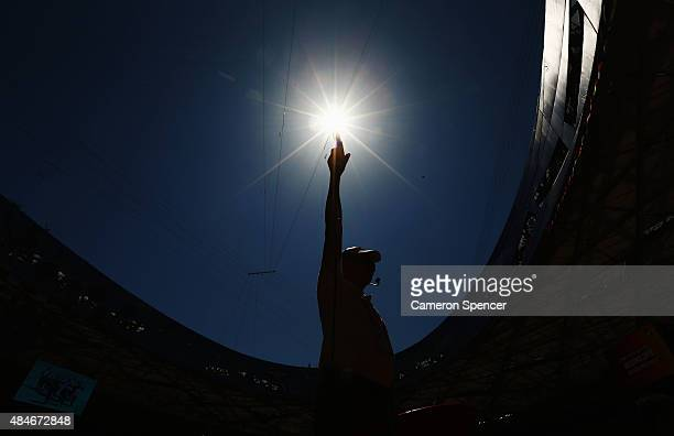 A starter makes final preparations ahead of the 15th IAAF World Athletics Championships Beijing 2015 at the Beijing National Stadium on August 21...
