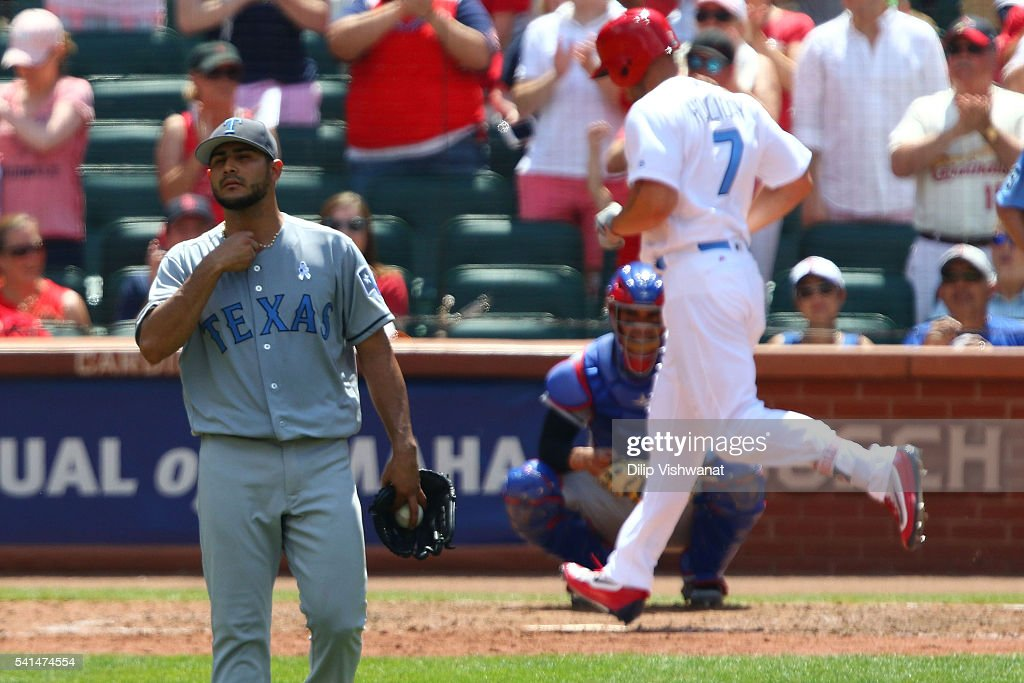Starter Martin Perez #33 of the Texas Rangers reacts after allowing a solo home run against the St. Louis Cardinals in the sixth inning at Busch Stadium on June 19, 2016 in St. Louis, Missouri.