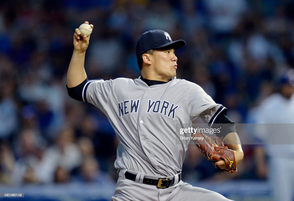 Starter Masahiro Tanaka of the New York Yankees delivers a pitch during the first inning against the Chicago Cubs at Wrigley Field on May 20 2014 in...