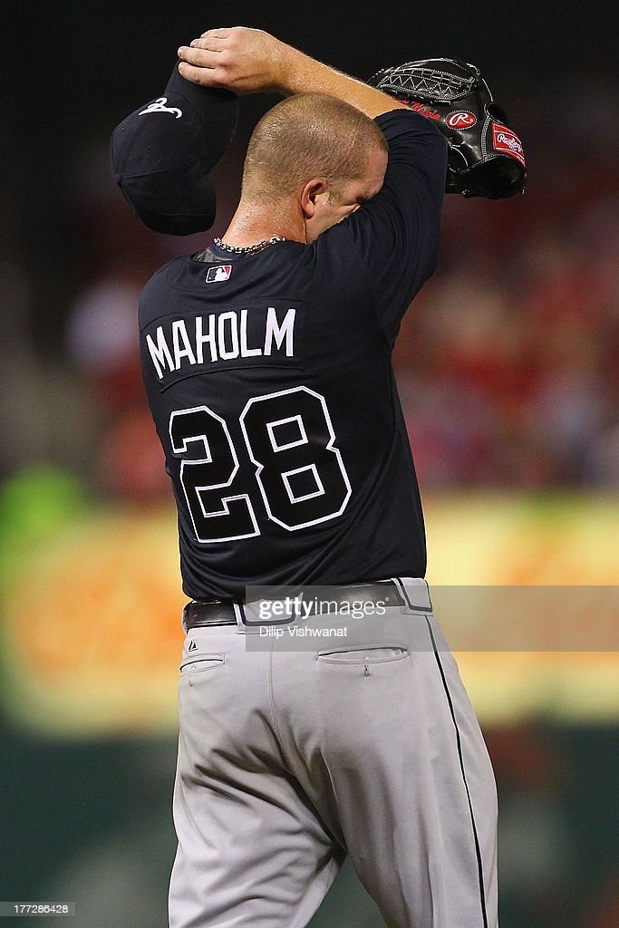 Starter <a gi-track='captionPersonalityLinkClicked' href=/galleries/search?phrase=Paul+Maholm&family=editorial&specificpeople=585406 ng-click='$event.stopPropagation()'>Paul Maholm</a> #28 of the Atlanta Braves reacts after allowing three runs against the St. Louis Cardinals in the fifth inning at Busch Stadium on August 22, 2013 in St. Louis, Missouri.