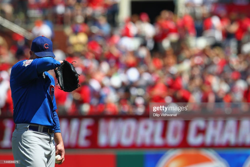 Starter <a gi-track='captionPersonalityLinkClicked' href=/galleries/search?phrase=Paul+Maholm&family=editorial&specificpeople=585406 ng-click='$event.stopPropagation()'>Paul Maholm</a> #28 of the Chicago Cubs reacts to giving up a home run against the St. Louis Cardinals at Busch Stadium on May 15, 2012 in St. Louis, Missouri.